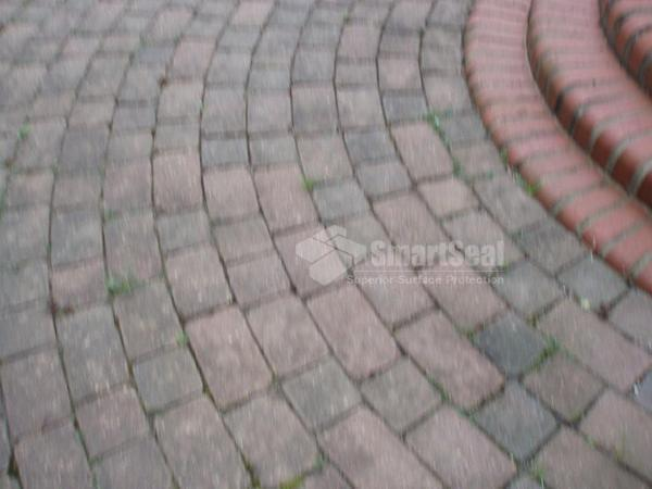 Close up of block paving requiring cleaning