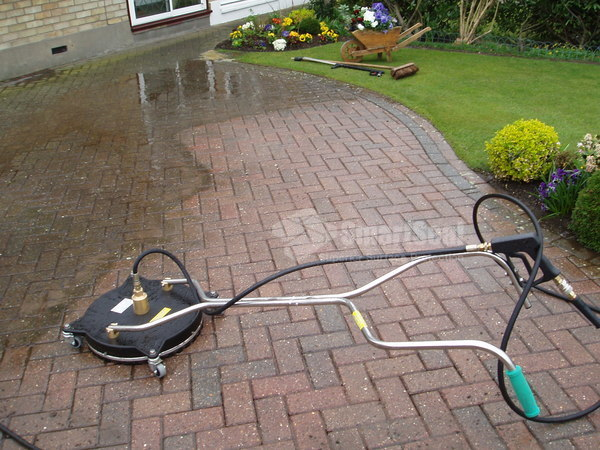 Rotary headed pressure washer on blocks